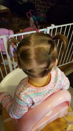 Connected ponies from back, up into pigtails. Perfect way to keep hair off of their little necks!