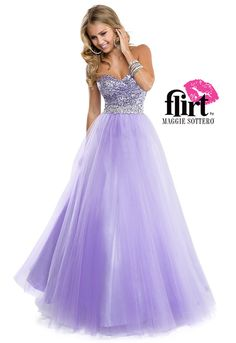 Flirt Prom's tulle ballgown with gathered sequin bodice and beaded belt. Dress finished with center back zipper closure.