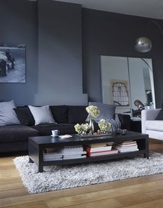Using different shades of one colour can help make a living room look modern and sophisticated