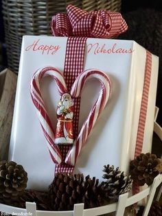 Happy Nikolaus. 2 small candy canes form a heart and a chocolate Santa.