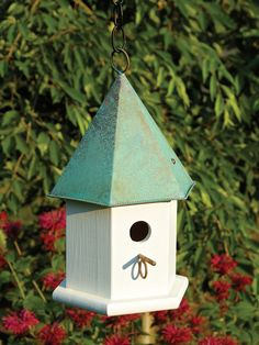 Heartwood Enjoy the Copper Songbird Bird House in your garden today! A stylish hexagonal body of solid cypress and a six sided solid copper roof. Hanging loop and matching copper perch complete the lo Bird House Plans, Bird House Kits, Diy Bird Feeder, Humming Bird Feeders, Cool Bird Houses, Wooden Bird Houses, Copper Roof, Bird Aviary, House Yard