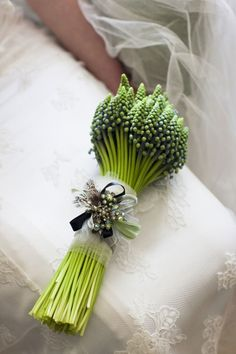 Stunning and unique bouquet. Gorgeous details on the ribbon, yet utterly simple overall. Rustic, chic, perfect.