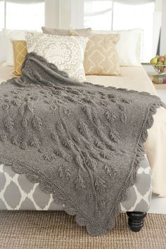 Leaf Blanket pattern by Inge Spungen   from Vogue Knitting 2013/2014, posted on Ravelry; size 10 needles, 2300+ yards yarn