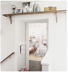 I love the shelf - always trying to get T to do this for me!!  (and if you look closely, you can see the stripes on the wall in the room.)