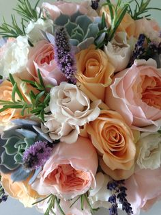 Juliette and Peach Avalanche roses. With mint, lavender, succulents and Rosemary makes for a pretty bridal bouquet that smells amazing.