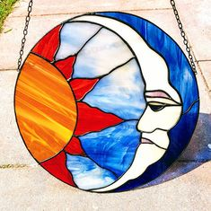 Tiffany stained glass suncatcher of sun and moon sun and moon