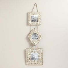 One of my favorite discoveries at WorldMarket.com: Antique-White 3-Tier Esme Hanging Wall Frames