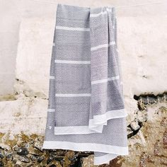 The Tawulo is a classic and original addition to the Mungo flat-weave towel range. This textured, monochrome range is punctuated with a few bold pops of colour in the striped details. One of the defining characteristics is that no two Tawulo's are the same, thanks to the random rolling of the weft yarn in the weaving process. Guest Towels, Hand Towels, Winter Leaves, Color Pop, Colour, Stones Throw, Weaving Process, Bath Sheets, Charcoal Color