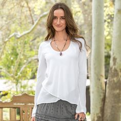 """EQUILIBRIUM BLOUSE--It all balances out in our bias-cut, easy-fit pullover with a crisscross asymmetrical front hem. Super soft and feminine with scoop neck. Modal. Machine wash. Imported. Exclusive. Sizes XS (2), S (4 to 6), M (8 to 10), L (12 to 14), XL (16). Front approx. 24-1/2""""L, back approx. 27-1/2""""L."""