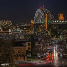 Evening looking over Sydney Harbour Bridge, with The Rocks in the foreground. (by Dunleavey Photography)