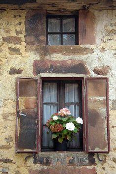 flowers in the window Pineda de la Sierra. Burgos, Spain