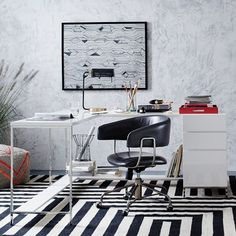 Modern and modular. With a high-gloss lacquer finish and airy steel legs, the Lacquer Storage Desk Set features two separate work surfaces and a bottom shelf to prop your feet up on. The attached box file keeps papers and supplies organized and out of the way.