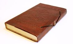 Tree of Life Leather Bound Journal/ Art Book/sketch book. Hand made with intricate artwork and recycled paper. This piece has a beautiful imprint of a tree on the leather cover and patterns in the front and back of the book.