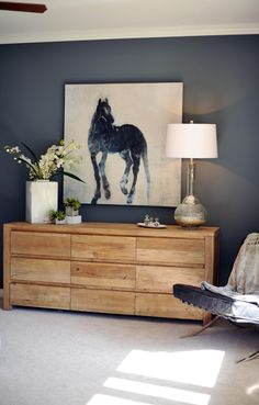 gorgeous wall color and dresser love.  yeah...and that lamp...yum