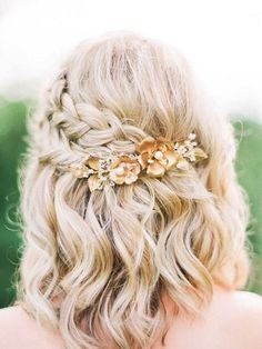 Pretty plaits aren't just for long-haired ladies – you too could work a braided style on your big day! We love this plait and wave combo finished off with a statement clip. Image: Pinterest