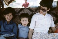 Suu Kyi, son Alexander (centre) and a friend on a houseboat in Kashmir in 1976