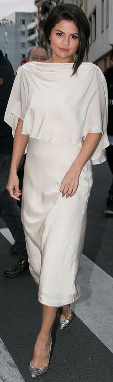 Who made Selena Gomez's white gown and glitter pumps?