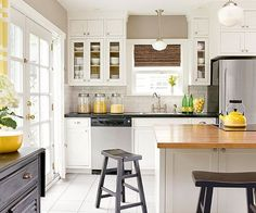 Love of white kitchen! And the pops of yellow. More kitchen remodel ideas: http://www.bhg.com/kitchen/remodeling/makeover/design-your-own-kitchen-remodel/