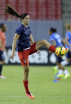 Alex Morgan warming up before the match against France on June 14, 2014, in Tampa. (Chris O'Meara/AP)