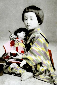 A girl in kimono feeding her doll some rice.  Hand-colored photo, 1910, Japan.   Image via Blue Ruin 1 of Flickr
