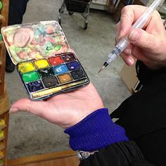 via a visual journey by Lisa Cheney-Jorgensen.....   Gina and Krista made their own traveling watercolor sets out of antique eyeshadow compacts!