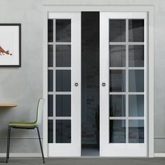 Double Pocket Decca White sliding door system in three size widths with Clear Glass incorporating etched lines. #whitepocketdoors #glazedpocketdoors #pocketdoorpair