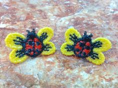 Lace applique ladybug stud earrings with hand painted glitter.  By Embellished Charms