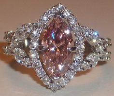 Pink diamond marquise with halo. A pink diamond version of Cory's grandmother's ring, just without the panthers. Vintage Engagement Rings, Diamond Engagement Rings, Halo Engagement, I Love Jewelry, Fine Jewelry, Metal Jewelry, Jewelry Rings, Beautiful Rings, Diamond Jewelry