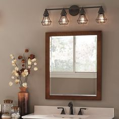Bring an element of industrial cool into your bathroom with a bronze-finish cage light fixture.