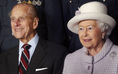 The Duke of Edinburgh & Queen Elizabeth II pose for a photo during their visit to RAF Lossiemouth