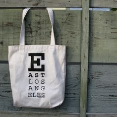 Jill made the logo for this 100% recycled tote bag for a school project.