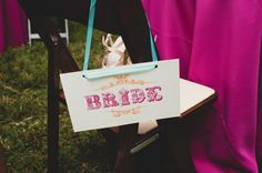 "Love the design of these ""bride and groom"" signs"
