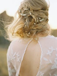 Delicate Bridal Updo with Flowers  | by Anna Peters Photography