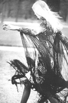 I would die to have her kimono, the fringe is amazing, and the black and white photo makes everything 10x better.