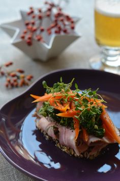 Danish open faced sandwich with peppered pork, kale pesto and pickled new carrots.