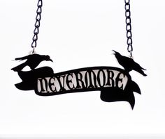 Nevermore Scroll Necklace by Cherryloco Inspired by Edgar Allan Poe's classic poem 'The Raven', this gorgeous statement piece measures 3.75 inches in length and is attached to a 16 inch black chain.