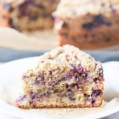 Blueberry Sour Cream Coffee Cake Recipe Breads, Breakfast and Brunch with all-purpose flour, whole wheat flour, granulated sugar, baking powder, baking soda, salt, large eggs, sour cream, vanilla extract, fresh blueberries, all-purpose flour, granulated sugar, brown sugar, ground cinnamon, chopped pecans, butter, toasted coconut