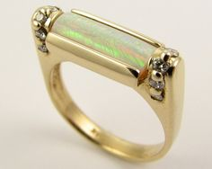 Sacred Scroll Opal Ring. MUST HAVE!!! It's my birth stone too!!!