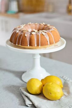 Almond Lemon Pound Cake, a moist bread that's a perfect compliment to any party (like our Baby Gender Reveal, a brunch or baby shower!!) topped with a sweet lemon glaze and sliced almonds. It's a light dish that is dairy-free and soy-free!   See some of the fun DIY details from our Gender Reveal and get this sweet recipe!   FreshMommyBlog.com  Made with @Silk Unsweetened Vanilla Almond Milk [ad] #silksiptospoon