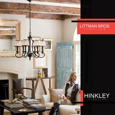 This @hinkleylighting chandelier ties the decor of this farmhouse chic inspired living room perfectly.