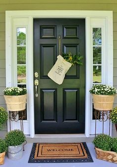 Front Door Paint Colors - Want a quick makeover? Paint your front door a different color. Here a pretty front door color ideas to improve your home's curb appeal and add more style! Exterior Doors, Porch Planters, Black Front Doors, Front Porch Decorating, Fall Door Decorations, Farmhouse Front Porches, Painted Front Doors, Porch Decorating, Porch Makeover