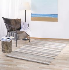 Ocean Stripes Rug, a neutrally coloured striped undyed wool rug http://www.therugswarehouse.co.uk/white-rugs/ocean-stripes-cream-rug.html #NeutralDecor #Rugs #WoolRugs