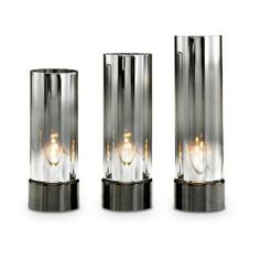 "REFLECTIVE TEALIGHT CYLINDERS Item: P90638 Unique glass cylinders mesmerize with a dazzling light show. Set includes one of each height: 7½"" (19 cm) h, 8½"" (22 cm) h, 9½"" (24 cm) h; 3"" (8 cm) diam. Metal base. Use with tealights, sold separately."