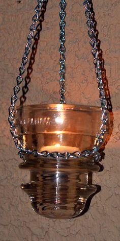 Vintage, electrical glass insulator hanging candle holder.