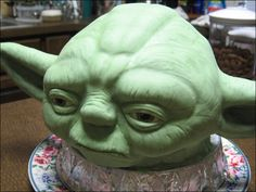Star Wars Yoda Cake - Taking my love of cooking for people & combining with artistic ability. Self-taught aside from basic decorating courses. This was my first sculpted cake and 4th cake in general (August 2010.) Decided to try Yoda from Star Wars since I'm a fan :)
