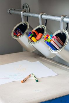 We love the industrial look of this craft corner, but the flexibility is what really sells us — you can add and subtract containers depending on what your kid is making. Leave the room and don't want her to get into the markers? Remove said container. It's as easy as that. Click through for more on this and other uses of carabiners.