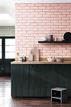 This kitchen from Little Greene pairs a pink that's just a little bit bubble gummy with a dark green (and an oak worktop) that balances it out nicely.