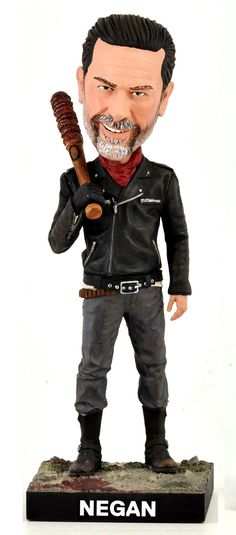"Negan bobblehead from the hit TV show THE WALKING DEAD. Features Negan holding ""Lucille"", his famous bat, after an encounter with an unfortunate victim"