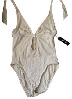 DKNY Cutout Swimsuit Nwt. Get the lowest price on DKNY Cutout Swimsuit Nwt and other fabulous designer clothing and accessories! Shop Tradesy now