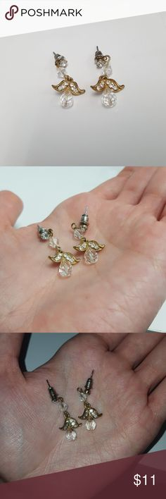 Gold Crystal Flower Petal Earrings ( gently worn ) These costume jewelry gold crystal flower petal earrings could almost pass as real deal. They are gently worn but in good condition.   Again, COSTUME JEWELRY.   Any green color in the picture is not on the earring but reflecting off my phone case, apologies. They are completely clear! Jewelry Earrings
